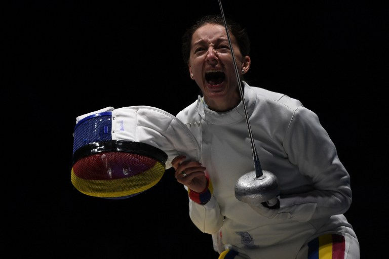 Romania's Ana Maria Popescu  celebrates after winning  the women's team epee quarter-final bout between US and Romania as part of the fencing event of the Rio 2016 Olympic Games, on August 11, 2016, at the Carioca Arena 3, in Rio de Janeiro. / AFP PHOTO / Kirill KUDRYAVTSEV
