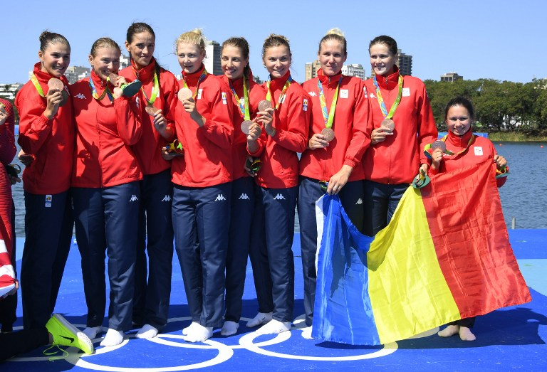 Bronze medallists Romania's Madalina Beres, Romania's Andreea Boghian, Romania's Adelina Bogus, Romania's Roxana Cogianu, Romania's Daniela Druncea, Romania's Laura Oprea, Romania's Mihaela Petrila, Romania's Iuliana Popa and Romania's Ioana Strungaru celebrate on the podium of the Women's Eight final rowing competition at the Lagoa stadium during the Rio 2016 Olympic Games in Rio de Janeiro on August 13, 2016. / AFP PHOTO / Damien MEYER