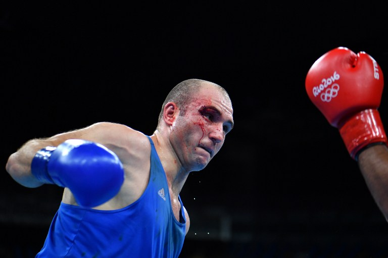 Romania's Nistor Mihai (L) fights Jordan's Iashaish Hussein during the Men's Super Heavy (+91kg) at the Rio 2016 Olympic Games at the Riocentro - Pavilion 6 in Rio de Janeiro on August 13, 2016.   / AFP PHOTO / Yuri CORTEZ