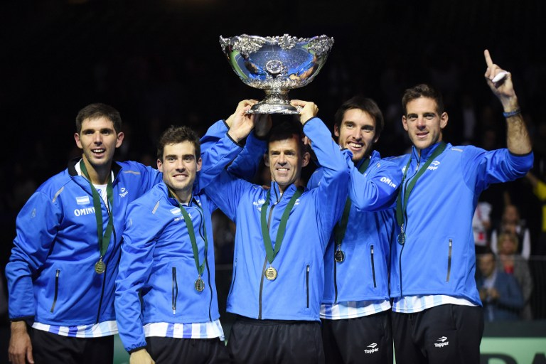 (L-R) Argentina' Guido Pella, Federico Delbonis, coach Daniel Orsanic, Leonardo Mayer and Juan martin del Potro celebrate with the trophy after winning the Davis Cup World Group final between Croatia and Argentina on November 27, 2016 at the Arena hall in Zagreb.  / AFP PHOTO / - / The erroneous mention appearing in the metadata of this photo by - has been modified in AFP systems in the following manner: [(L-R) Argentina' Guido Pella, Federico Delbonis, coach Daniel Orsanic, Leonardo Mayer and Juan martin del Potro ] instead of [L-R) Leonardo Mayer, Guido Pella, Federico Delbonis, Juan martin del Potro and coach coach Daniel Orsanic ]. Please immediately remove the erroneous mention from all your online services and delete it (them) from your servers. If you have been authorized by AFP to distribute it to third parties, please ensure that the same actions are carried out by them. Failure to promptly comply with these instructions will entail liability on your part for any continued or post notification usage. Therefore we thank you very much for all your attention and prompt action. We are sorry for the inconvenience this notification may cause and remain at your disposal for any further information you may require.