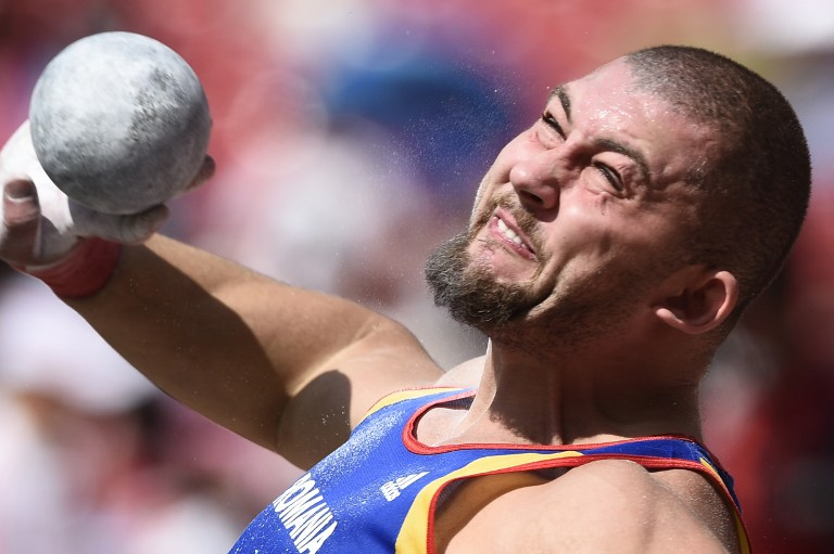 "Romania's Andrei Gag competes in the qualifying round of the men's shot put athletics event at the 2015 IAAF World Championships at the ""Bird's Nest"" National Stadium in Beijing on August 23, 2015.  AFP PHOTO / FRANCK FIFE / AFP PHOTO / FRANCK FIFE"