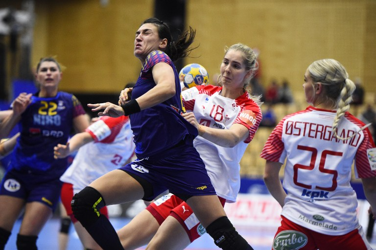 Romania's Cristina Neagu is stoped by Denmarks Mette Tranborg (2nd R) during the Women's European Handball Championship group 2 main round match between Denmark and Romania in Helsingborg, Sweden, on December 14, 2016.  / AFP PHOTO / TT News Agency / Bjorn Lindgren AND Emil LANGVAD / Sweden OUT