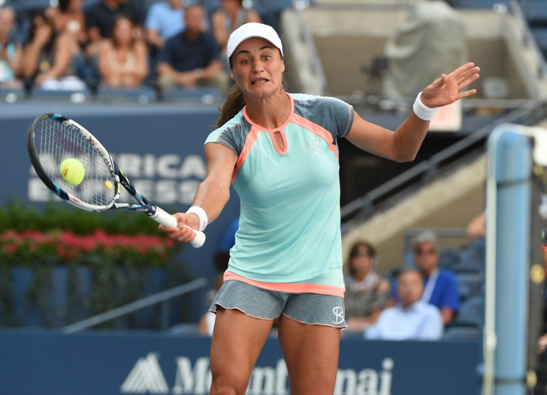 Monica Niculescu of Romania plays against Caroline Wozniacki of Denmark during their US Open 2016 women's single match at the USTA Billie Jean King National Tennis Center in New York on September 2, 2016. / AFP PHOTO / TIMOTHY A. CLARY