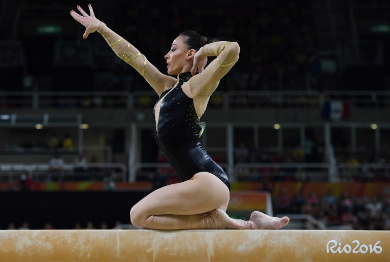 Romania's Catalina Ponor competes in the women's balance beam event final of the Artistic Gymnastics at the Olympic Arena during the Rio 2016 Olympic Games in Rio de Janeiro on August 15, 2016. / AFP PHOTO / Toshifumi KITAMURA