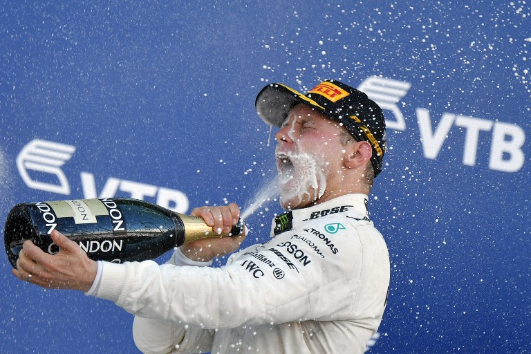 Mercedes' Finnish driver Valtteri Bottas celebrates on the podium after winning the Formula One Russian Grand Prix at the Sochi Autodrom circuit in Sochi on April 30, 2017. / AFP PHOTO / Andrej ISAKOVIC