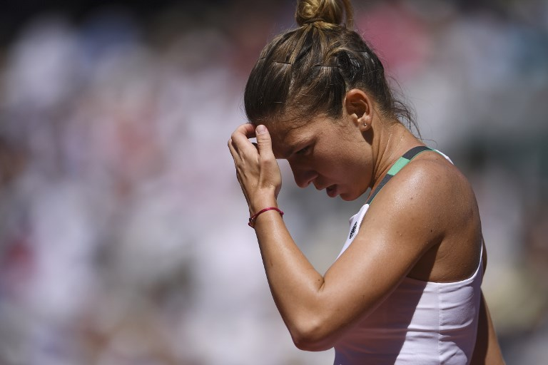 Romania's Simona Halep reacts after a point against Latvia's Jelena Ostapenko during their final tennis match at the Roland Garros 2017 French Open on June 10, 2017 in Paris.  / AFP PHOTO / Eric FEFERBERG